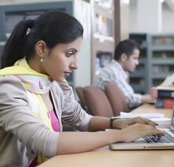 Students in library --- Image by © India Picture/Corbis